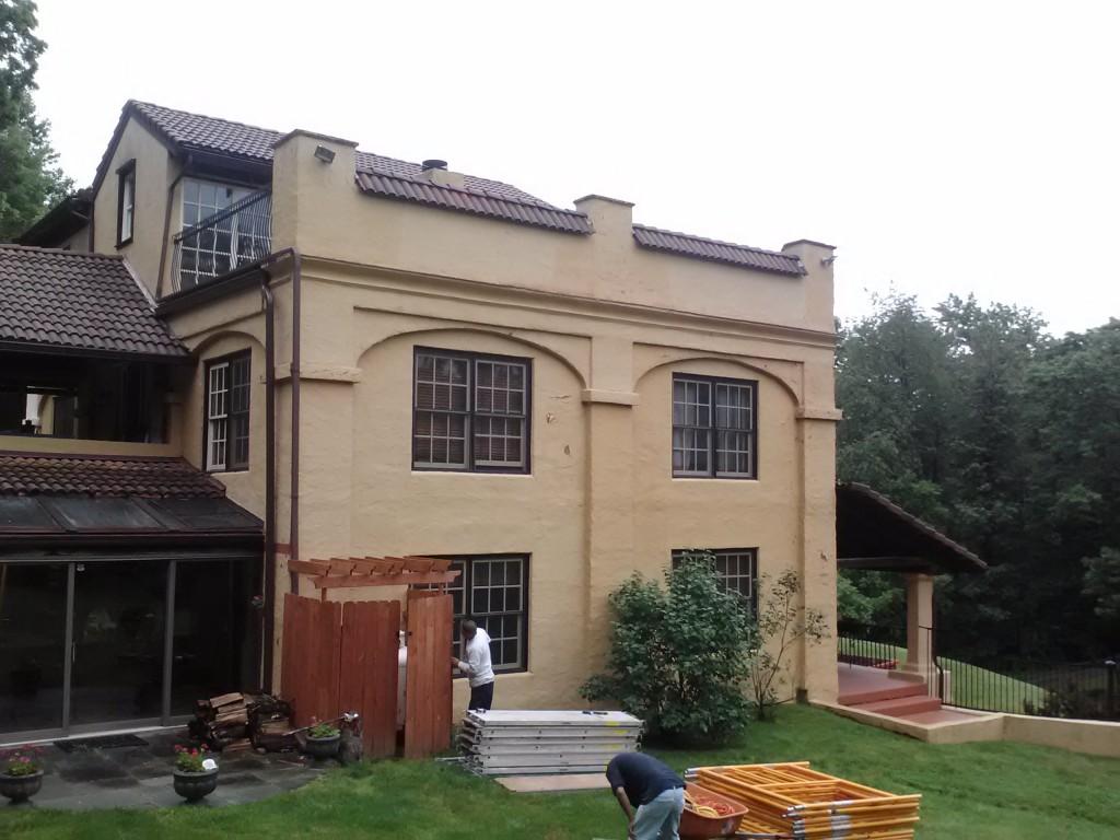 A repaired stucco facade.