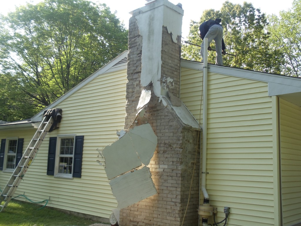 A chimney undergoing Stucco Repair